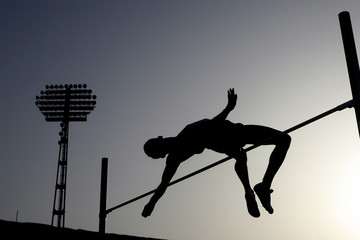 Silhouette of athlete jumping pole vault