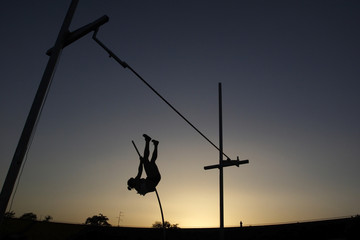 Pole vault during sunset
