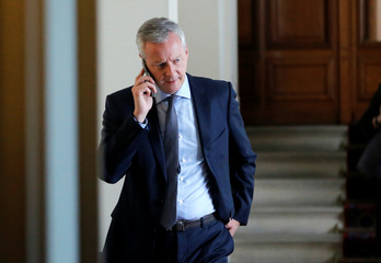 French Finance Minister Bruno Le Maire makes a phone call as part of a Franco-German joint cabinet meeting at the Elysee Palace in Paris