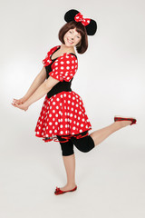 The girl in a mouse costume. Playful girl. Cosplay girl.