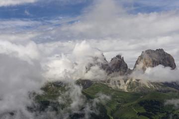 Sassolungo peaks among the clouds. Dolomites. Italy.