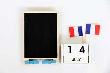 14 july Wooden calendar and blackboard Happy Bastille Day. Concept National Day France,Copy space,minimal style