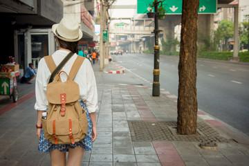 Happy asain girl walking on bangkok street