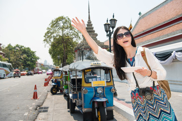 Hailing a tuk tuk taxi car on the street