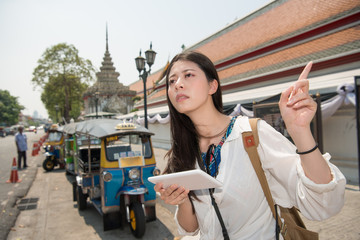 Travel woman with tablet at street in bangkok