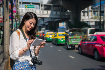 Woman using tablet 4g internet in outdoor