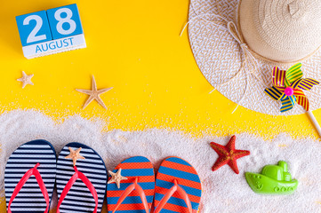 August 28th. Image of august 28 calendar with summer beach accessories and traveler outfit on background. Summer day, Vacation concept