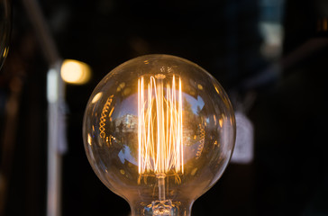 Close up glowing vintage light bulb