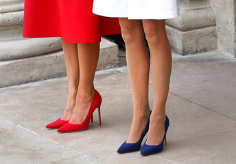 The shoes of Brigitte Macron, wife of French President Emmanuel Macron, and US First Lady Melania Trump are seen as they attend a welcoming ceremony at the Invalides in Paris