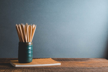 Concept of education pencil and book on table with filter effect retro vintage style