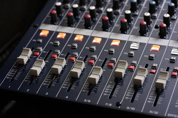 Professional Music Mixer Console with dial knob and slide bar. Professional music recording equipment.