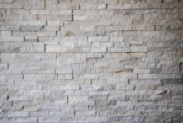 White texture rough cut stone wall background