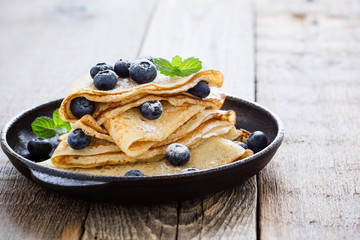 Crepes served with fresh blueberries and powdered sugar