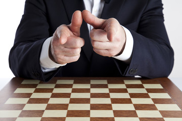 You have to think it over! A smart man in a dark suit with his fingers 