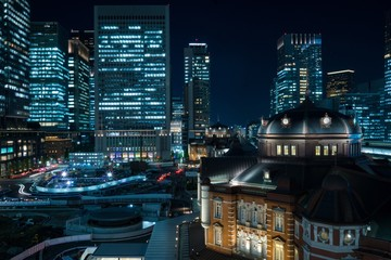 Illuminated Tokyo Station And Buildings In City