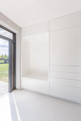 White interior with modern wardrobe