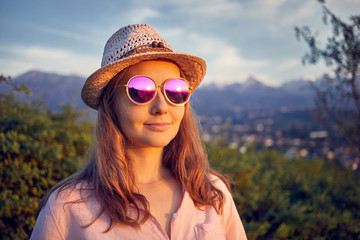 Portrait of beautiful woman in pink sunglasses