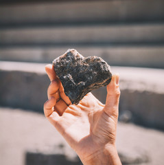 Cropped Image Of Person Holding Heart Shape Stone