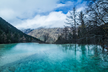 Scenic View Of Huanglong Against Cloudy Sky