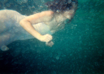 Woman Wearing Dress Swimming Undersea