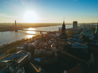 Amazing aerial sunset view over Riga city in Latvia. Statue of liberty - Milda