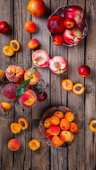 Apricots, Peaches. Fruits on a vintage wooden background.Food or Healthy diet concept.Super Food.Vegetarian.Copy space for Text.selective focus.
