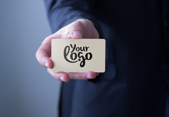 Businessperson Holding Card Mockup 2