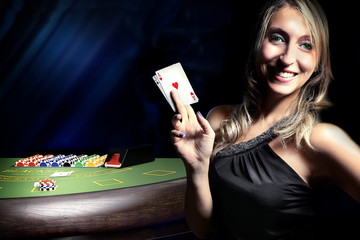 woman before dice throw on craps table at casino