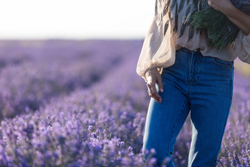 Midsection of a girl in a lavender field