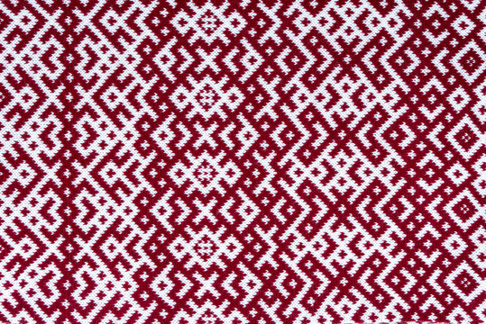 Knitted texture with the pattern of National symbol of Latvia - Lielvardes (place in Latvia) belt that is one of the most magnificent Latvian symbols. Latvian traditional historical ornaments.
