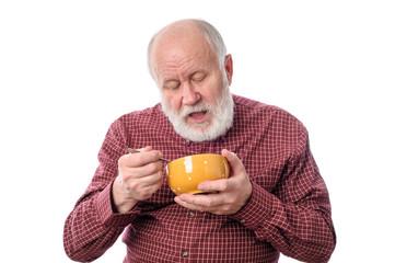 Senior man eating from oragne bowl, isolated on white