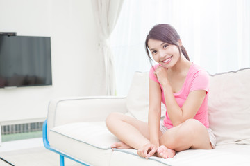 woman sit on sofa