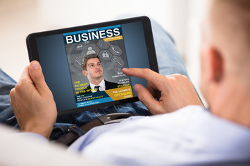 Businessman Looking At Business Magazine