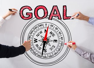 Executives Drawing Goal Concept On Whiteboard