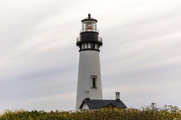 Lighthouse Against Soft Cloudy Sky