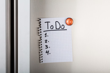 To Do List Attached With Orange Magnetic Thumbtack