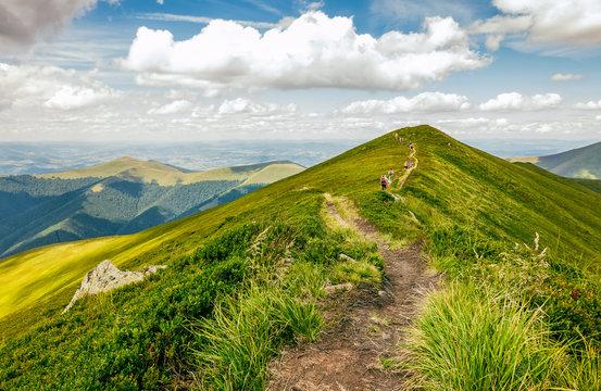 tourists on footpath through the mountain ridge