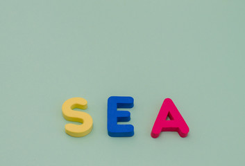 The word sea is from colored letters on a light green background