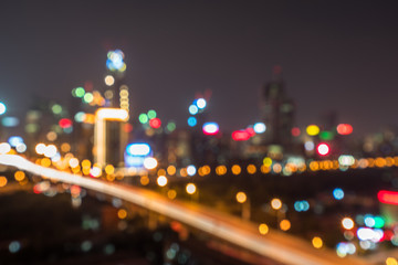 Abstract bright multicolored lights against city skyline.