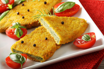 Spinach cutlets with tomato salad