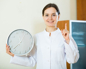 Female physician reminding about time of appointment