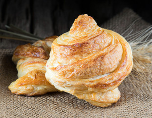 Tasty croissants on wooden background.