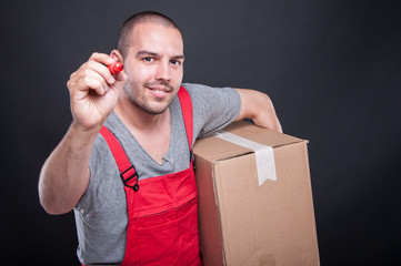 Mover guy holding box writing with red marker