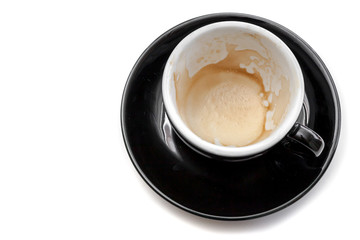 Wall Mural - Stain of coffee in black cup on white background isolated