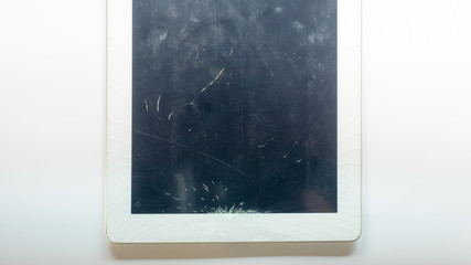Wall Mural - tablet computer with broken glass screen isolated on white background