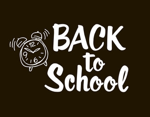 Back to school - lettering calligraphy phrase, handwritten text isolated on the black background. Fun calligraphy for typography greeting and invitation card or t-shirt print design.