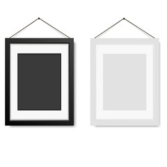 Realistic white and black blank frame hanging on the wall. Vector illustration