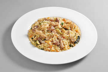 Dish of cous cous and meat