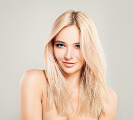 Beautiful Blonde Woman with Colored Hair. Blondie Fashion Model with Shiny Hairstyle and Natural Makeup