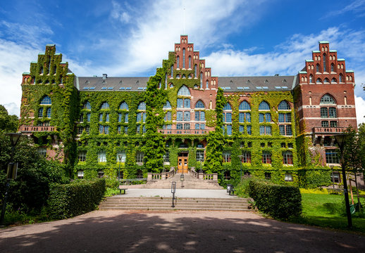 The building of the University Library in Lund, Sweden. The building of architecture overgrown with greenery